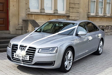 Audi wedding car with ribbon decorations